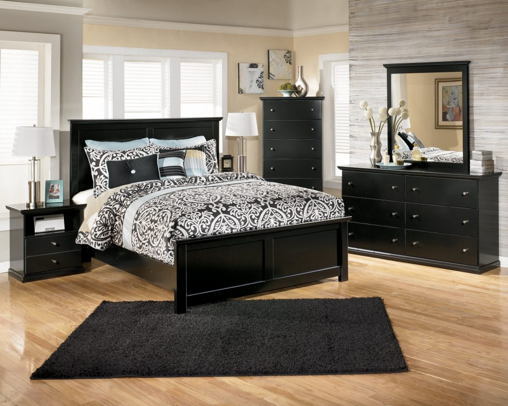 Black Wooden Bed With Black Bedding Set And Black Rug On Brown