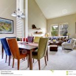 Large Beige Bright Living Room With Dining Room Table With Different