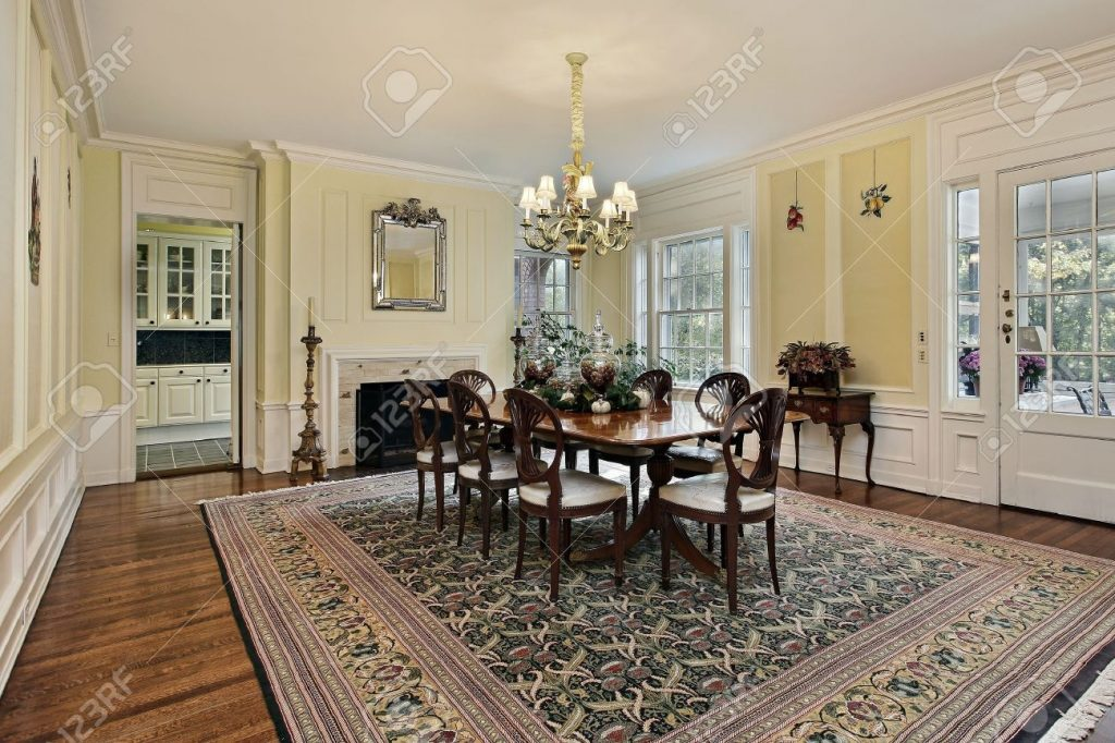 Large Dining Room In Luxury Home With Fireplace Stock Photo Picture