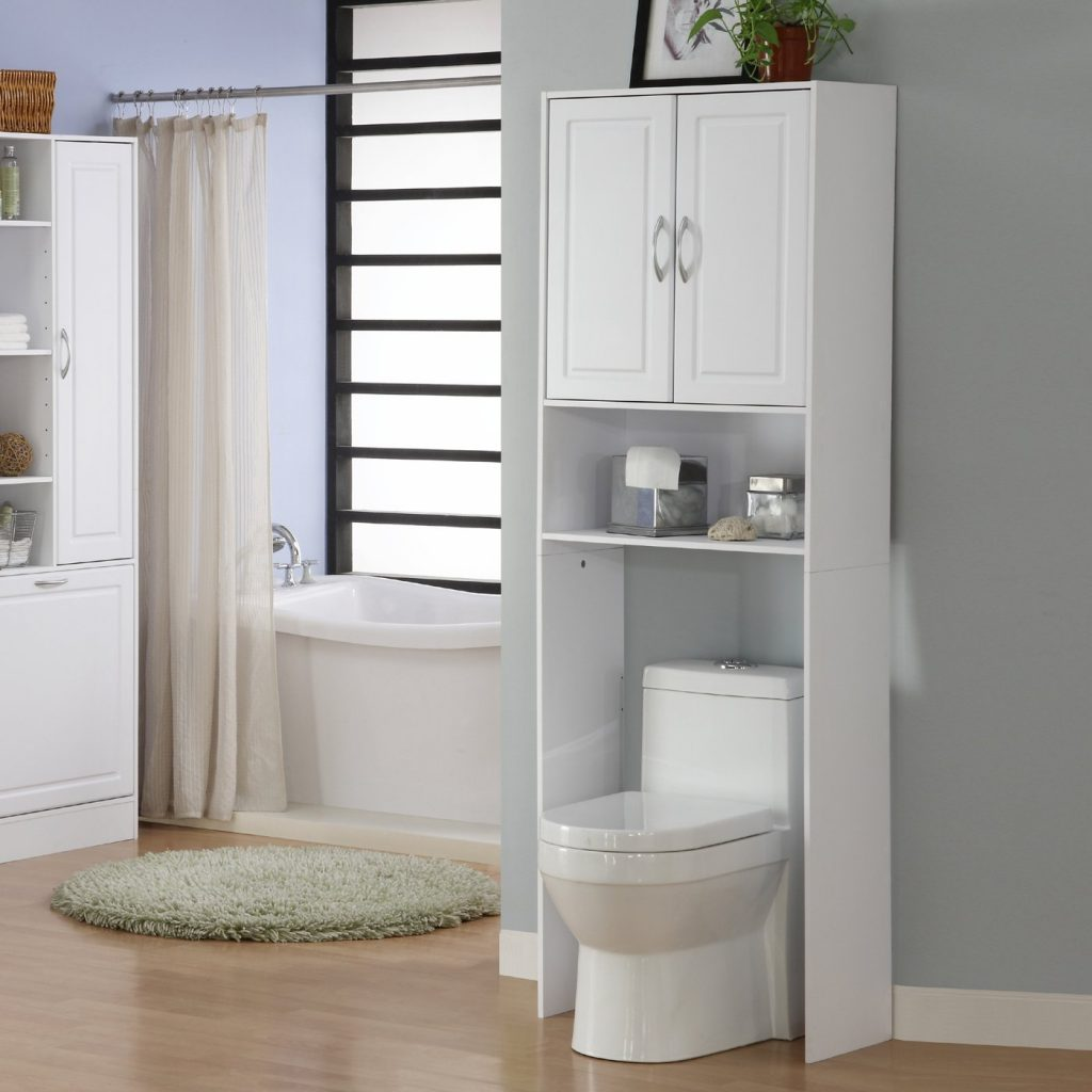 White Wooden Bathroom Cabinet With Shelf Above White Toilet Bowl On