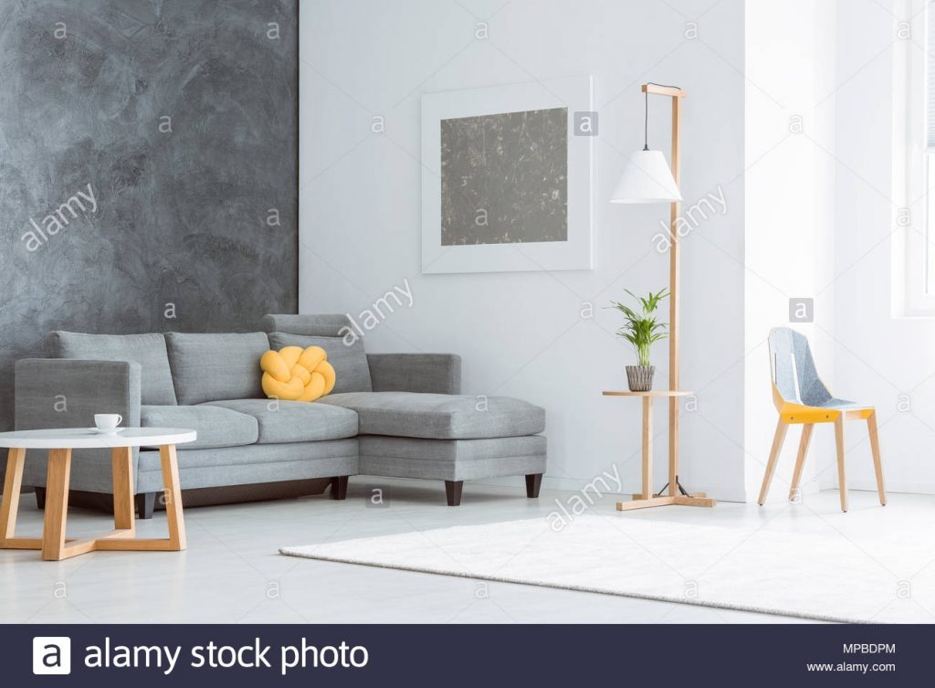 Silver Painting Above Grey Couch Set With Yellow Pillow In Spacious
