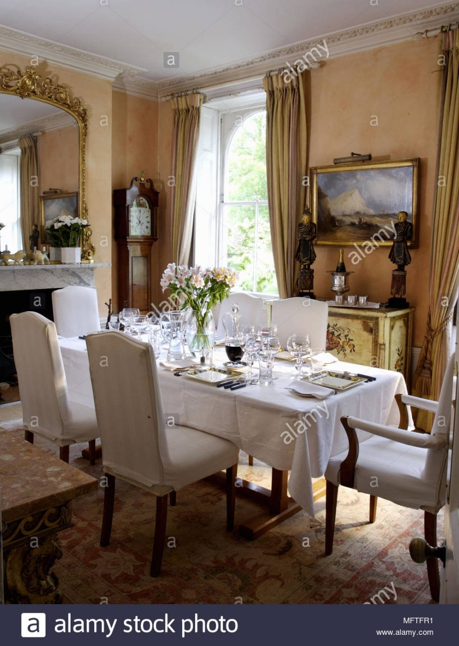 Table Set For Dinner In Traditional Style Dining Room Stock Photo