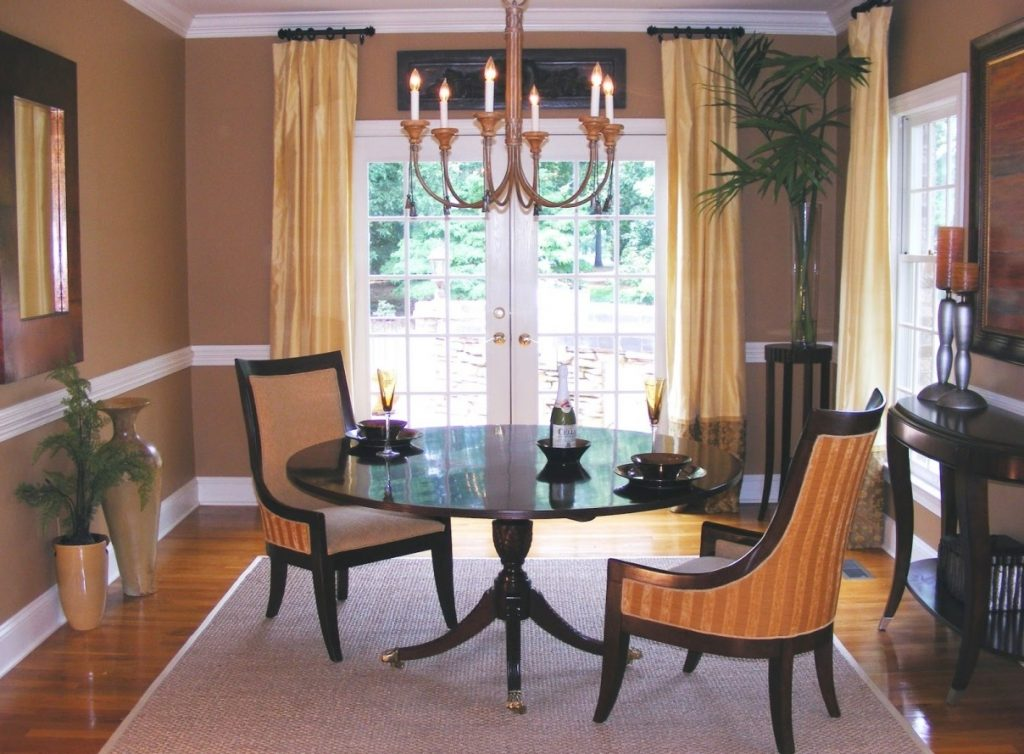 Dining Room Interesting Brown Chandelier Above Dark Table And Cream