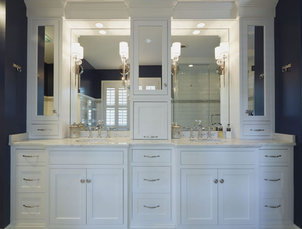 Double White Vanities With Mirrored Upper Cabinets And Lots Of