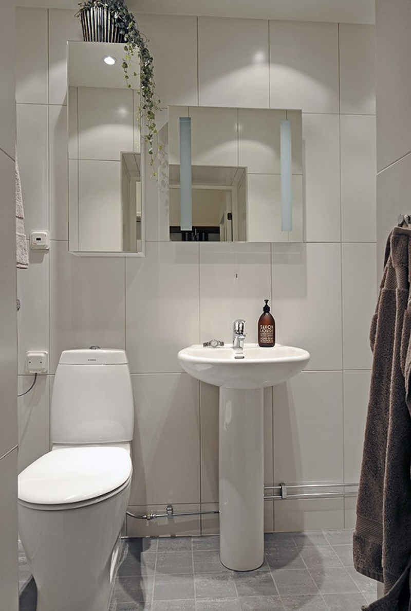 Modern White Bathroom With Oval Pedestal Sink And Toilet Seat Plus