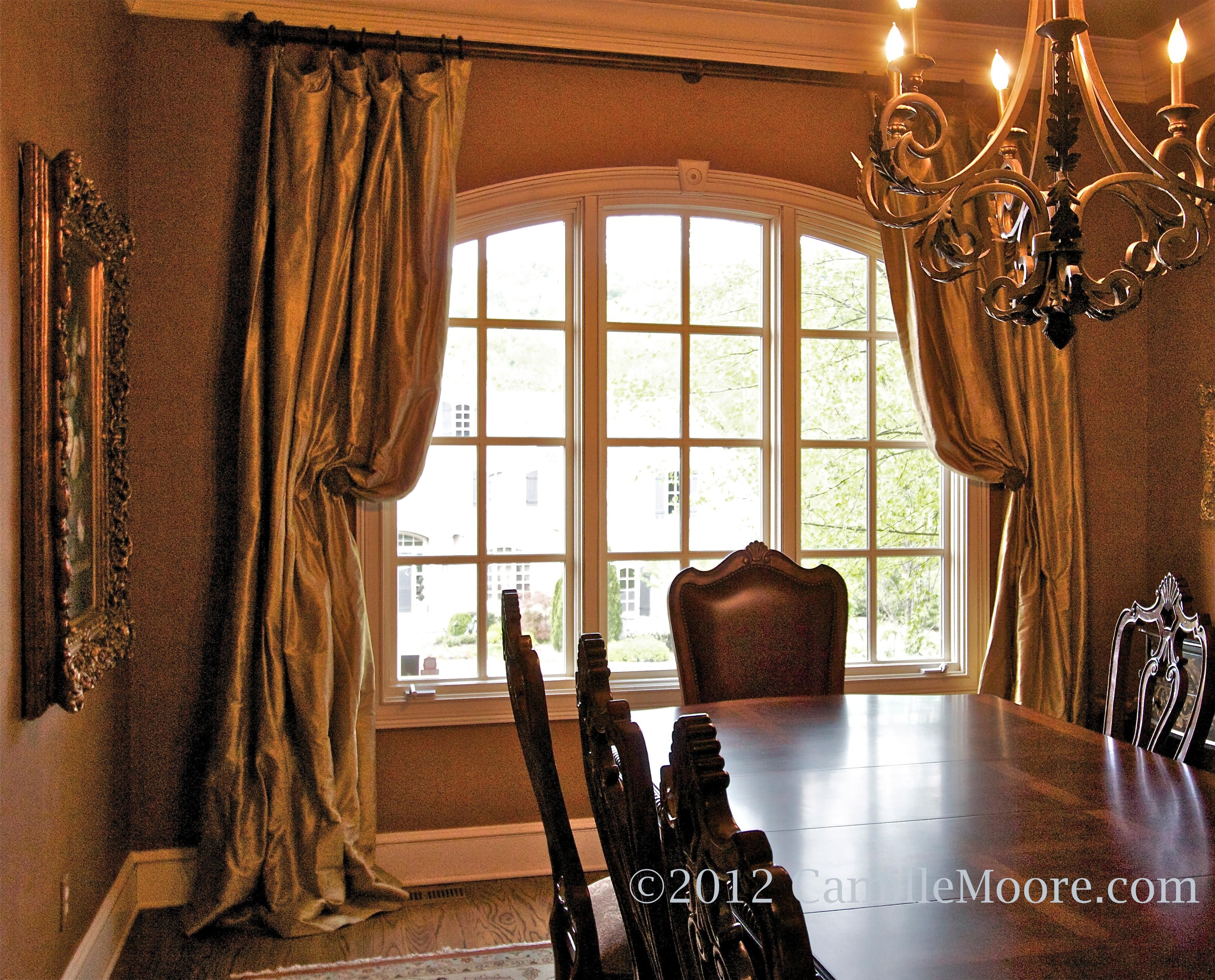 Silk Draperies Pulled Back On Arched Window In Dining Room Window Layjao