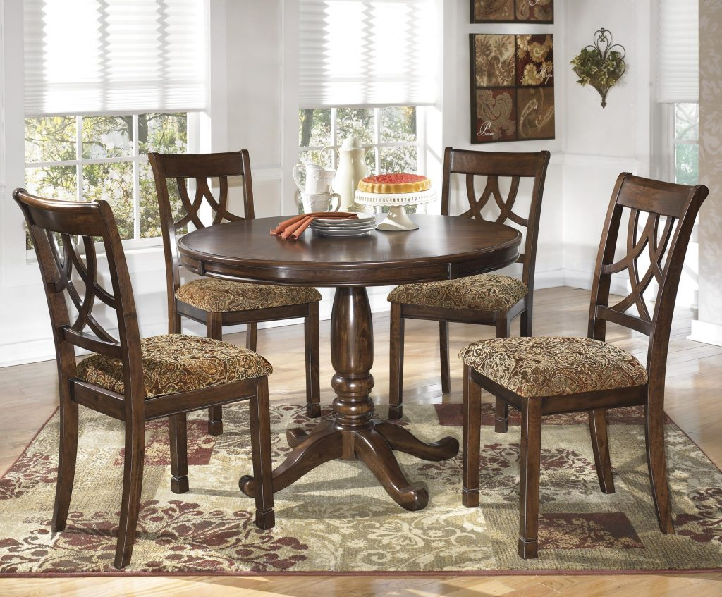 Ashley Signature Design Leahlyn 5 Piece Cherry Finish Round Dining
