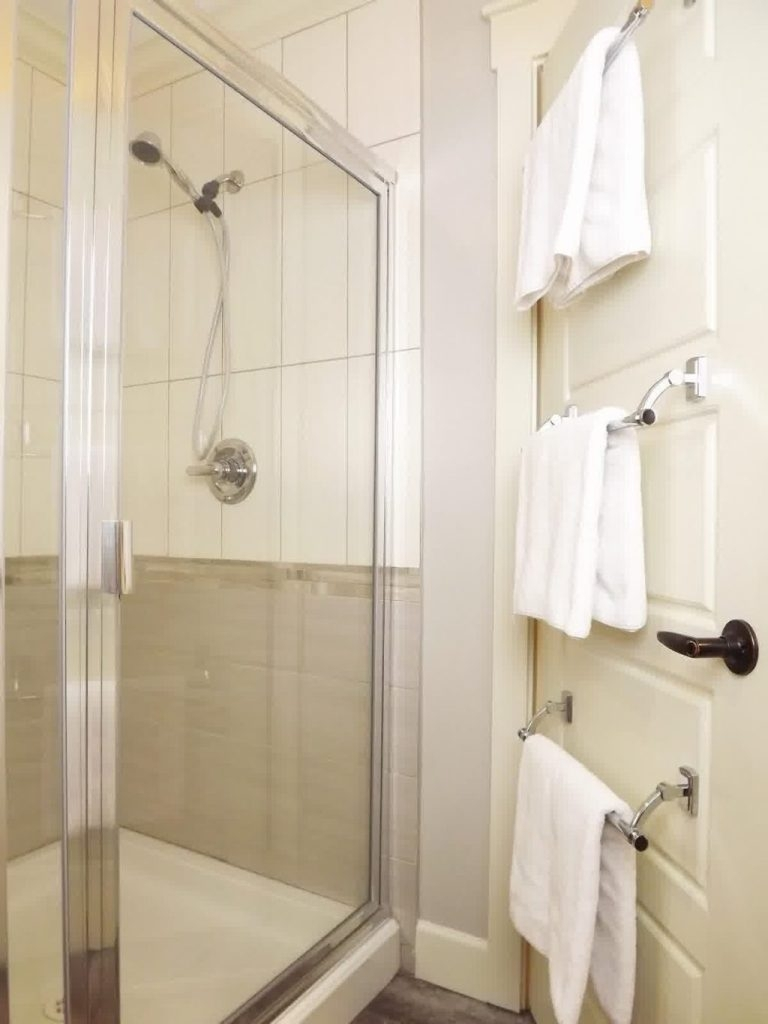 Glass Shower Enclosure With Three Metal Towel Bars For Small