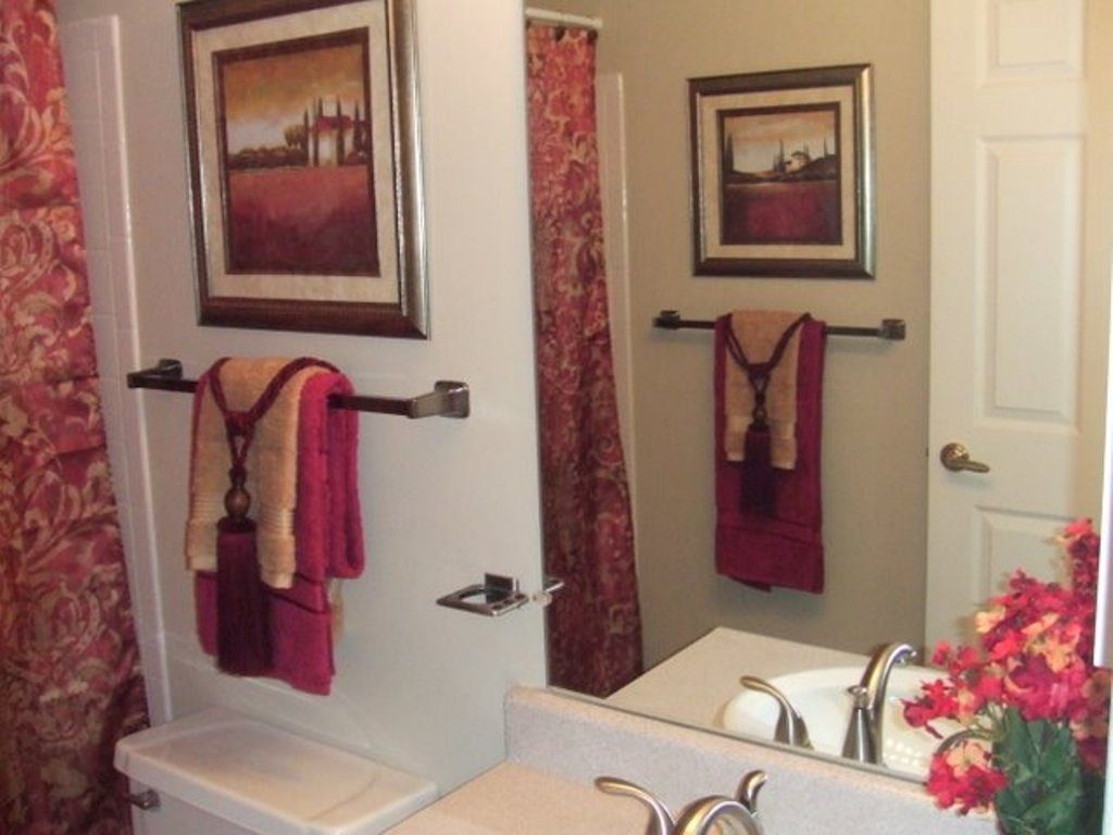 Luxury Bathroom Ideas With Red Decorative Towels Using Nice Tassels