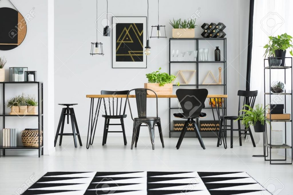 Black Chairs At Table In Scandinavian Style Dining Room With Stock