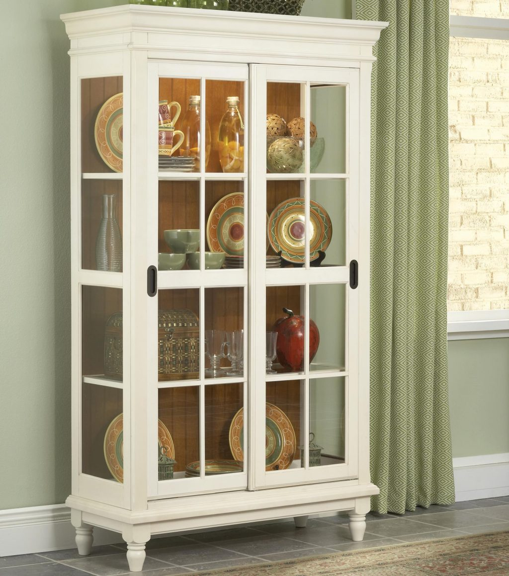 Curio Cabinet With Crown Moulding Turned Feet And Sliding Glass