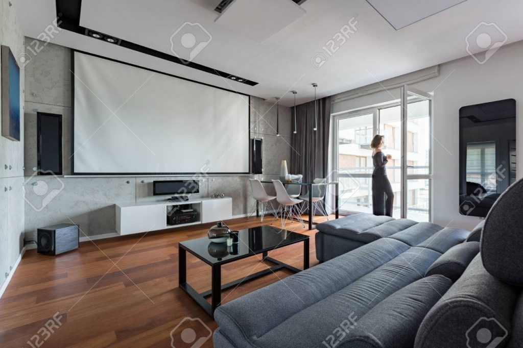 Gray And White Living Room With Sofa Table Balcony And Projector