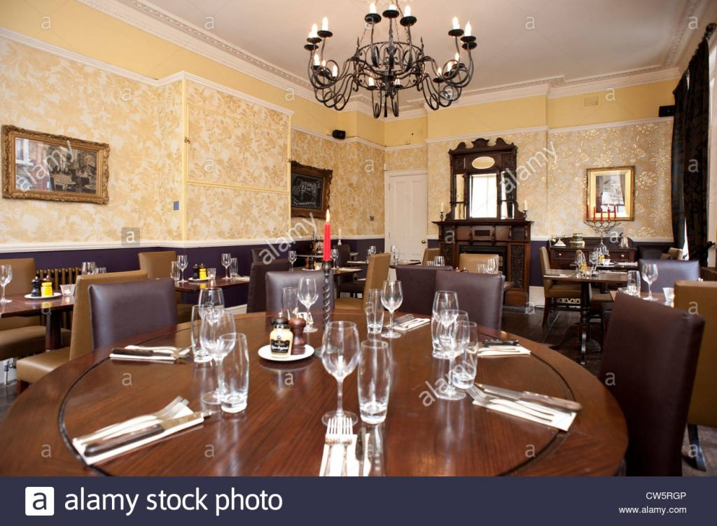 View Of The Interior Of A Victorian Style Dining Room Laid Out For