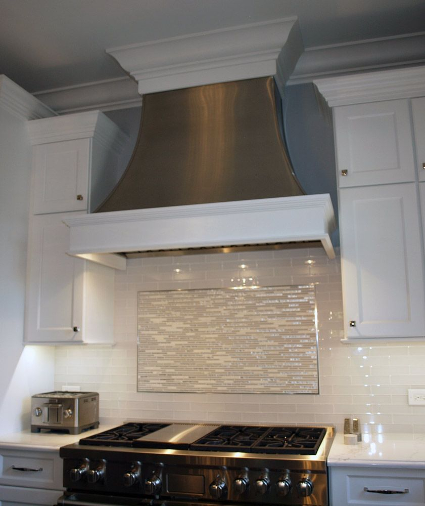 A Custom Metal Range Hood With Decorative Wood Trim Shows You Can