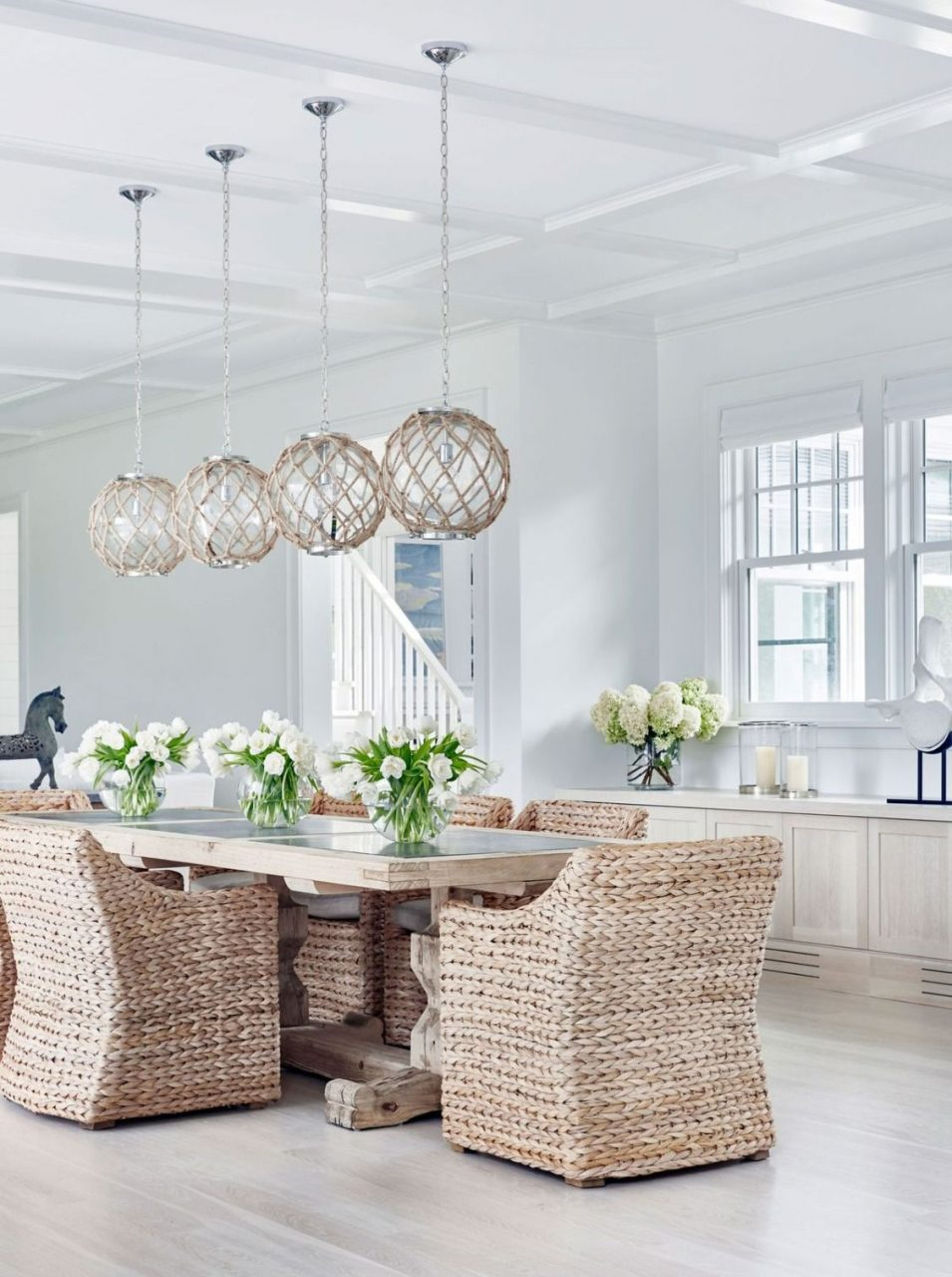 All White Dining Room With Rattan Detailing Solomons Island House