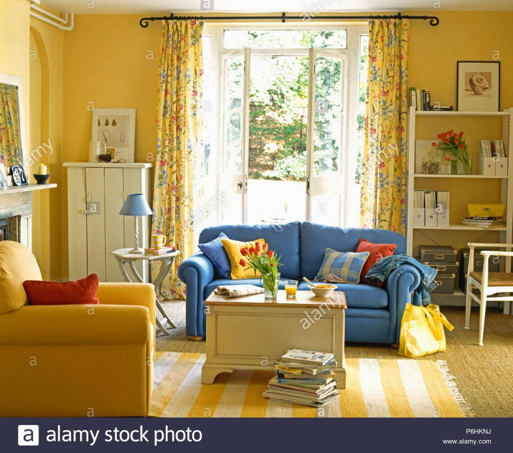 Blue Sofa And Yellow Striped Rug In Yellow Living Room With Painted