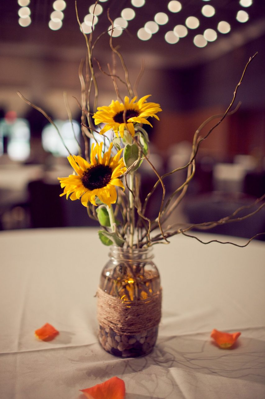 Centerpiece In Mason Jar With Sunflower River Rock And Curly