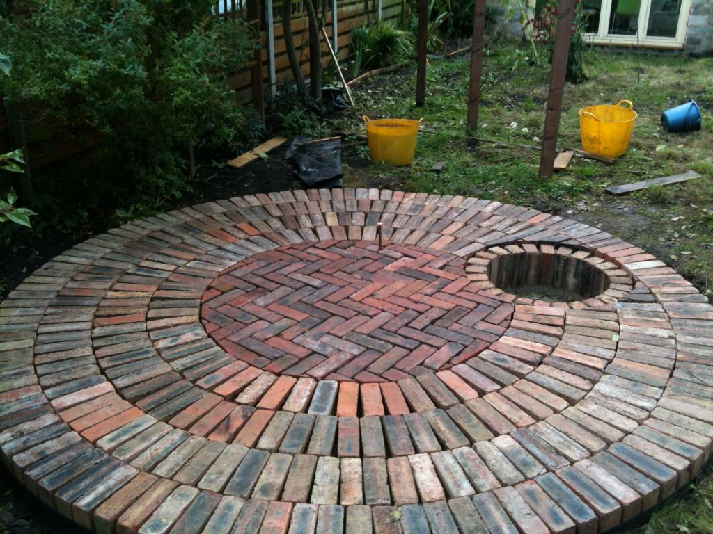 Circular Reclaimed Brick Patio With Recessed Fire Pit Including A