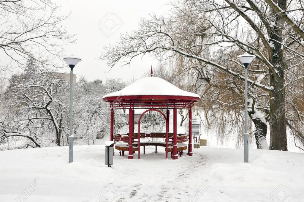 City Park With Trees And Metal Gazebo In Snow In Winter Grodno