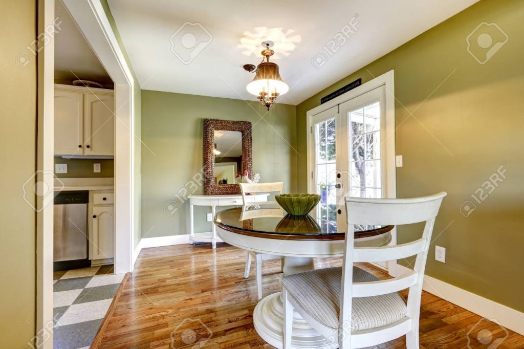 Dining Table Set In Room With Green Wall And White French Door Stock