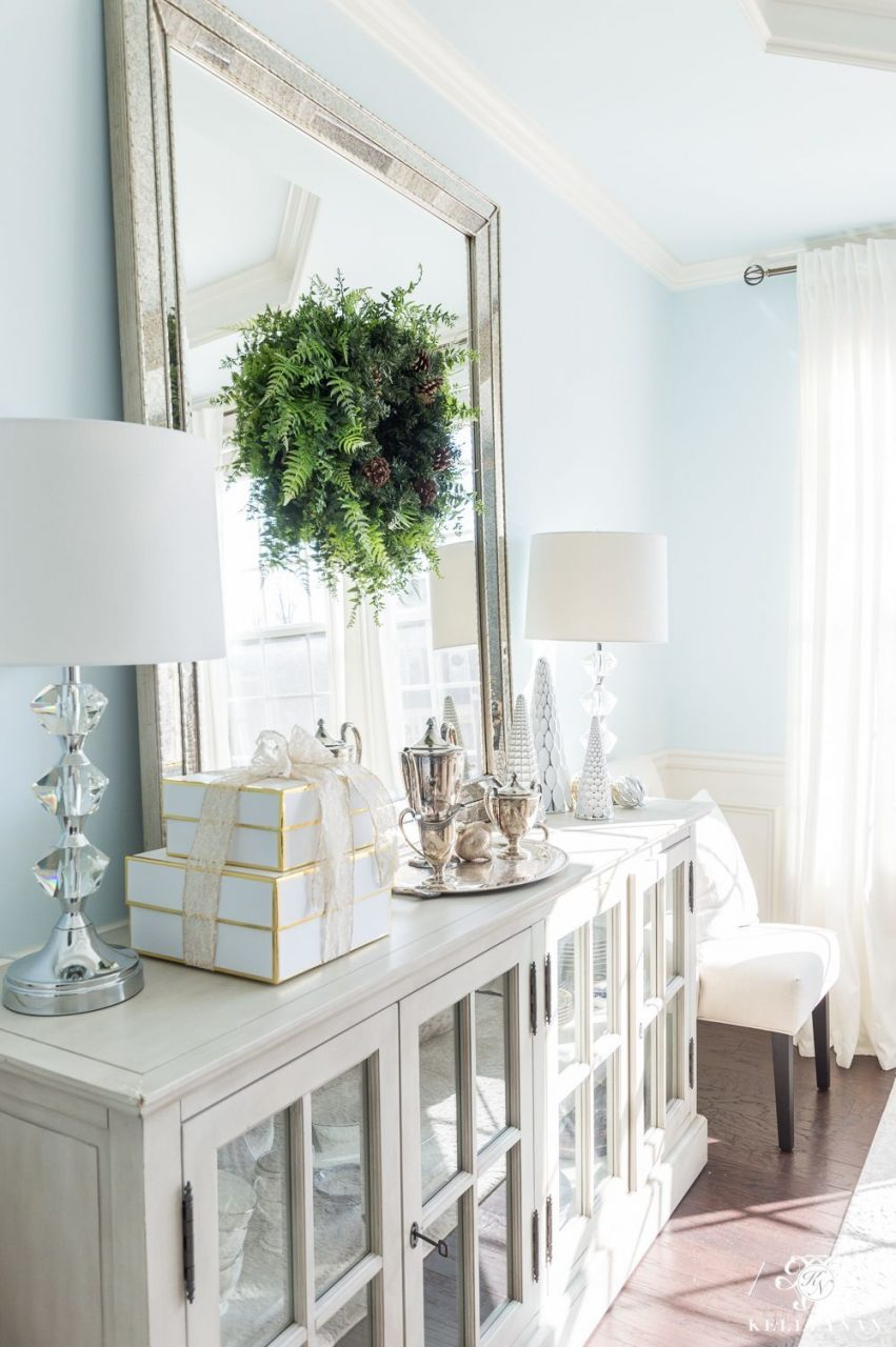 Elegant Dining Room Buffet With Christmas Decor And Leaning Mirror