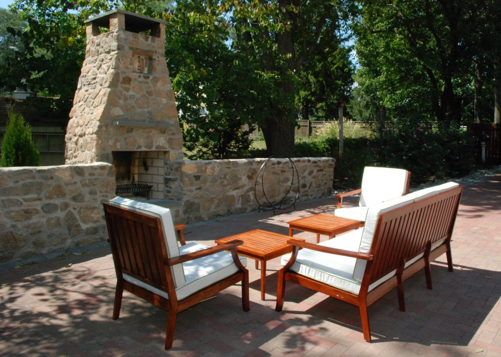 Excellent Stones Outside Fireplace With Custom Brown Wood Seater