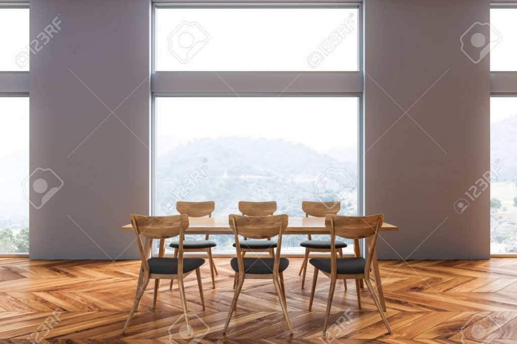Front View Of Dining Room With Gray Walls Wooden Floor Long Table
