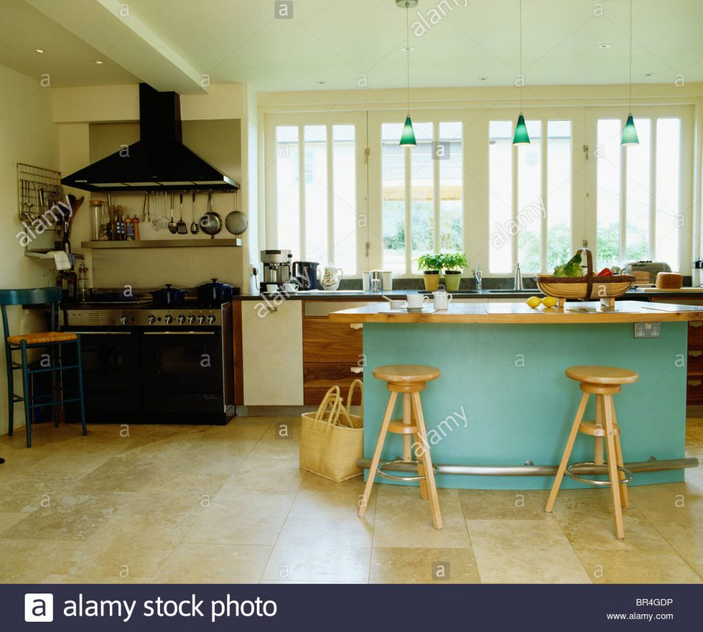 Limestone Flooring In Large Modern Kitchen With Wooden Stools At