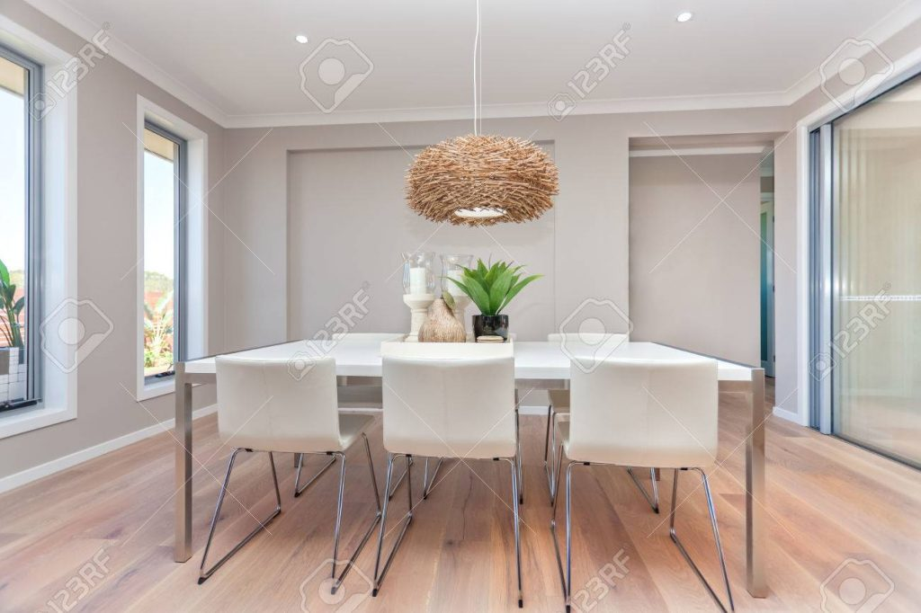 Luxury Dining Room And A Light Color Wooden Floor And Gray Walls
