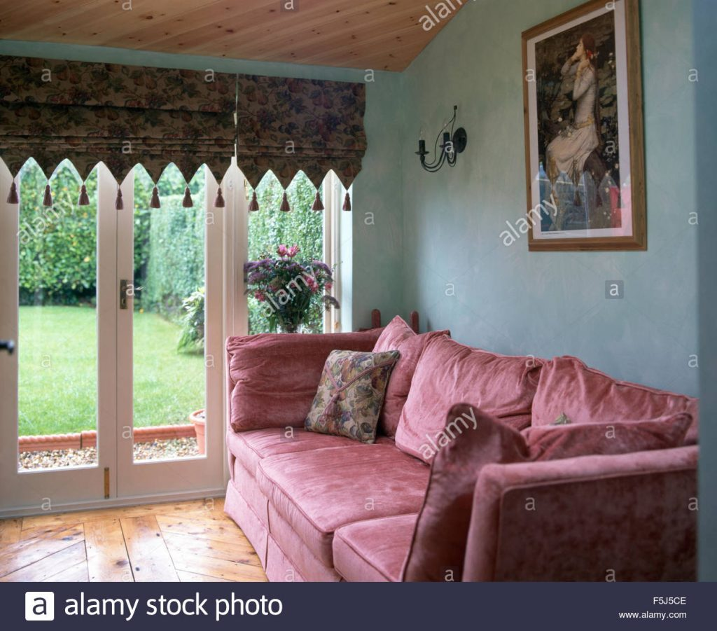Pink Velvet Sofa In A Blue Nineties Living Room With A Tasseled