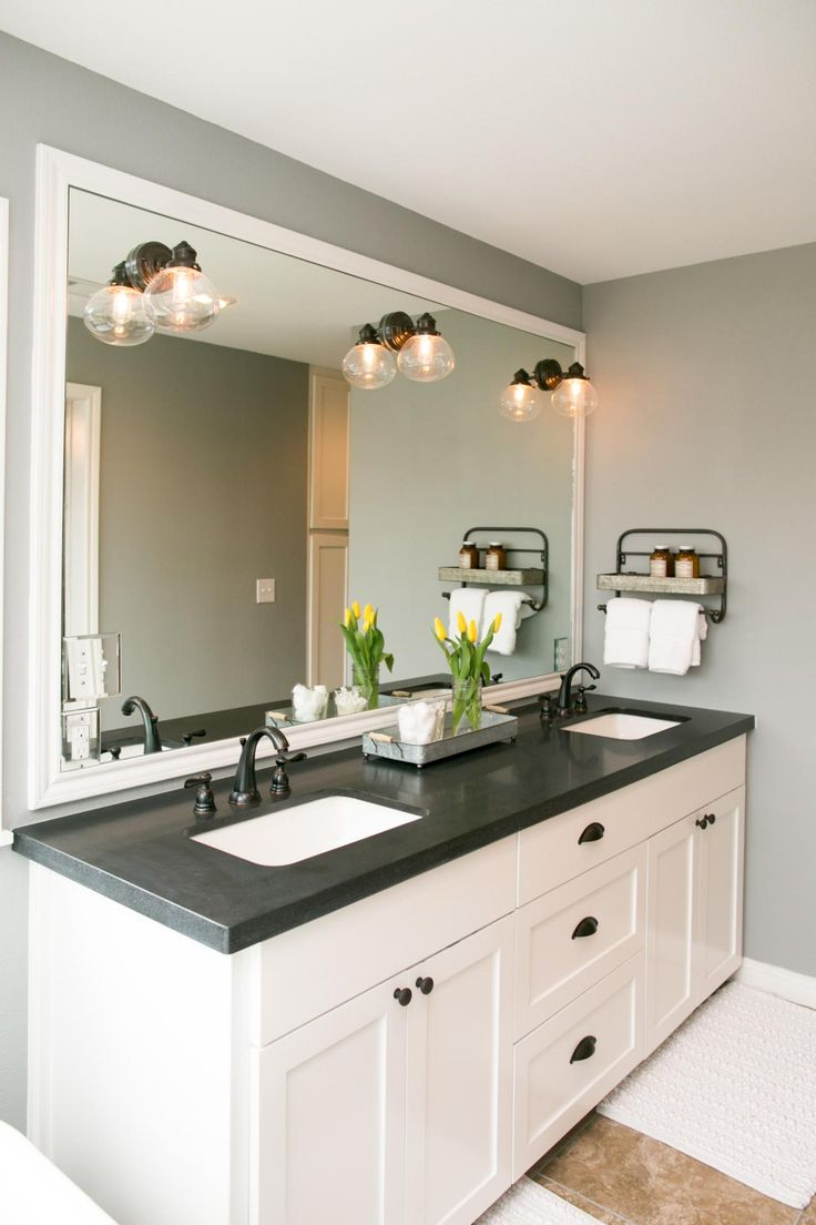 The Master Bathroom Has Black Granite Countertops With Spray On