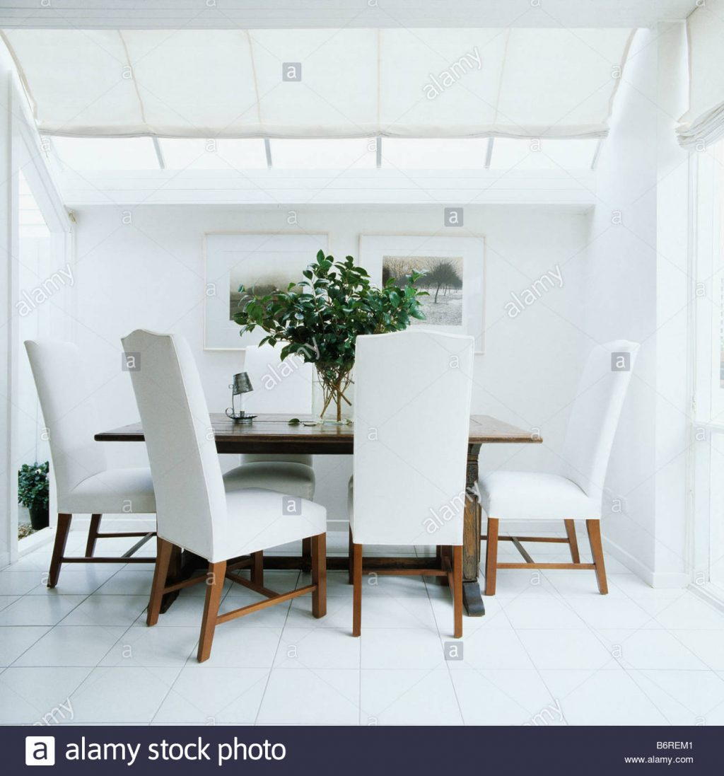 Upholstered White Dining Chairs In All White Modern Dining Room