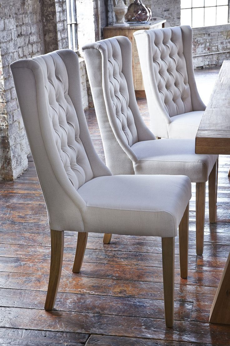 Upholstered Winged Chairs Will Give Your Dining Room An Air Of