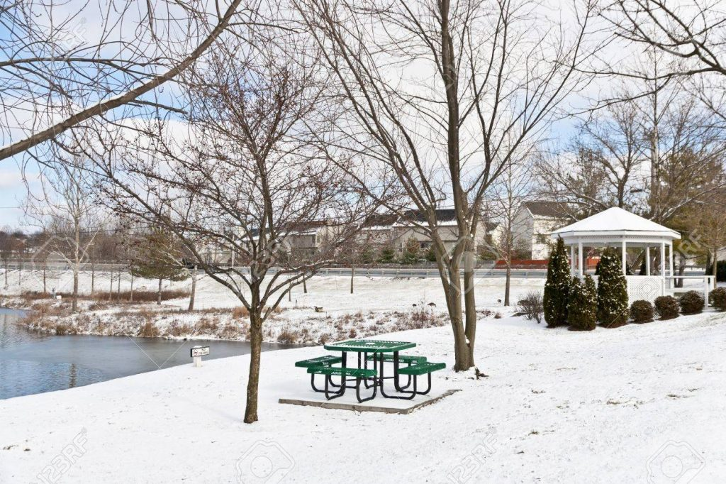 Winter City Scene With A Picnic Table And Gazebo At Neighborhood