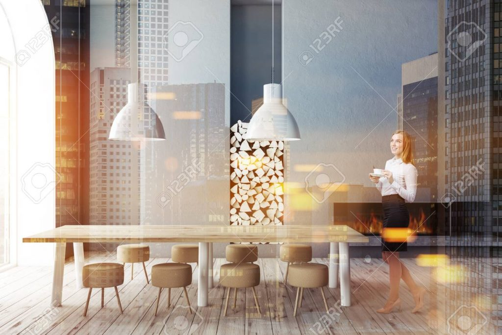 Woman In Modern Dining Room With Gray Walls Wooden Floor Long