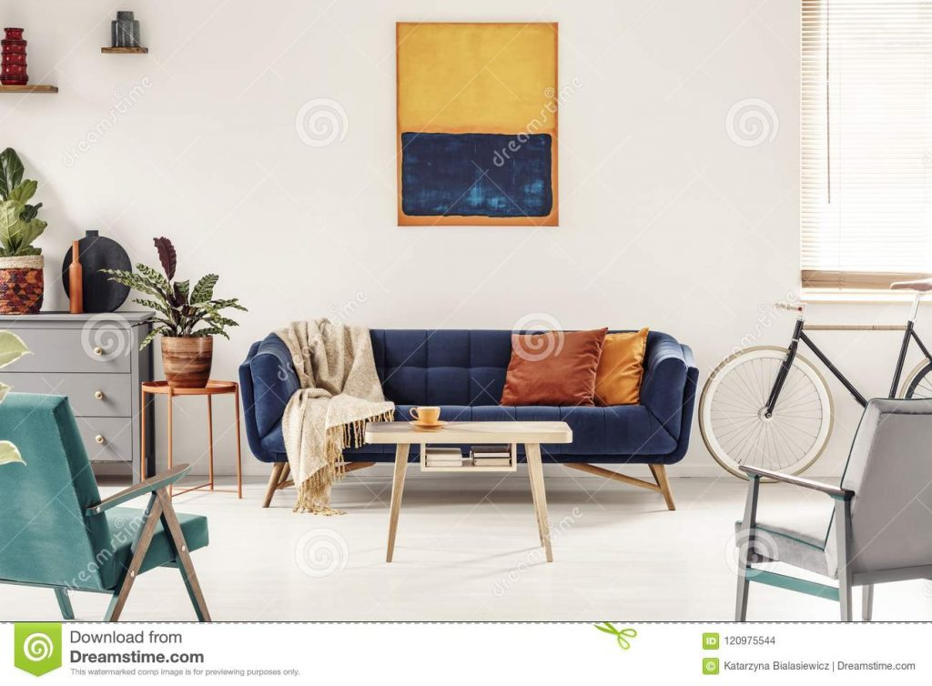 Yellow And Navy Blue Painting Above Sofa In Colorful Living Room