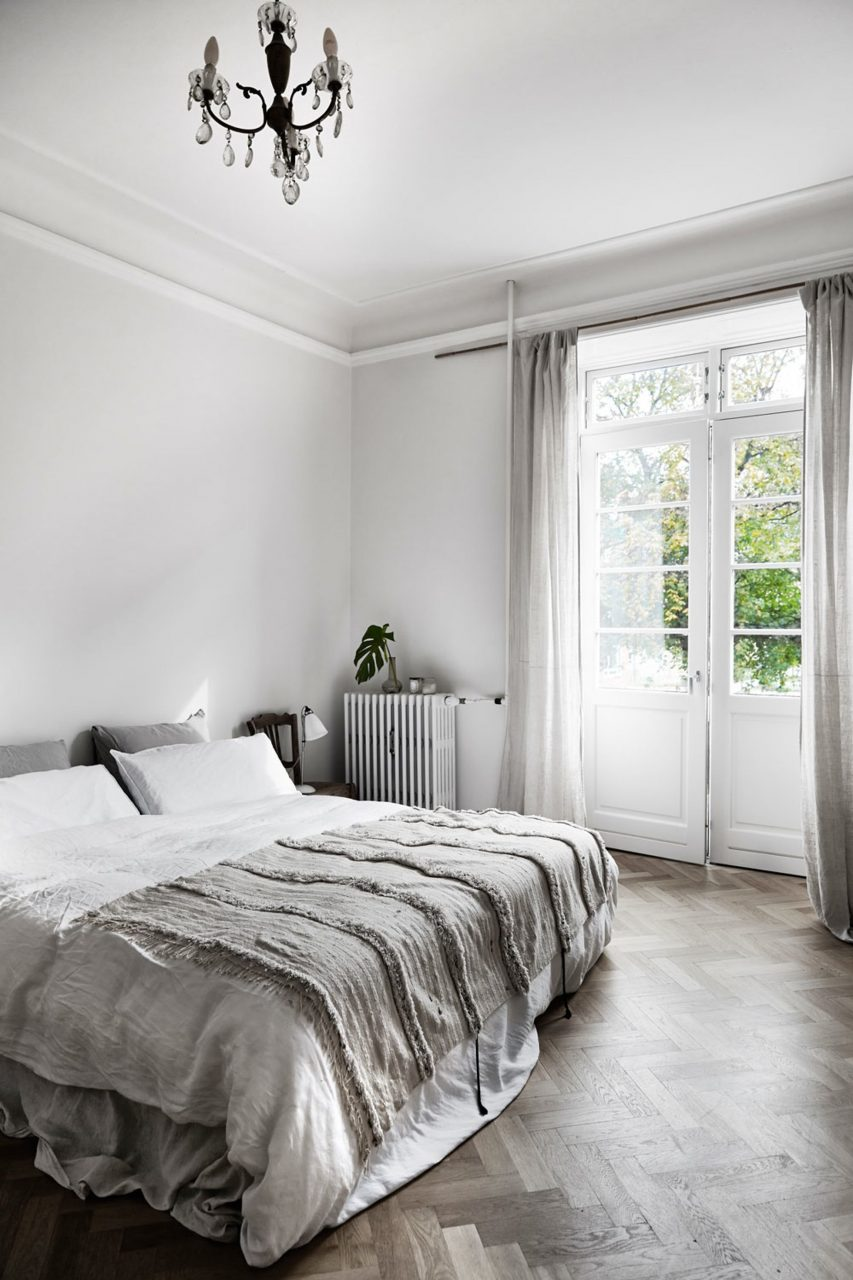 A Beautiful And Simple Grey Bedroom With Grey Bedding Light Grey
