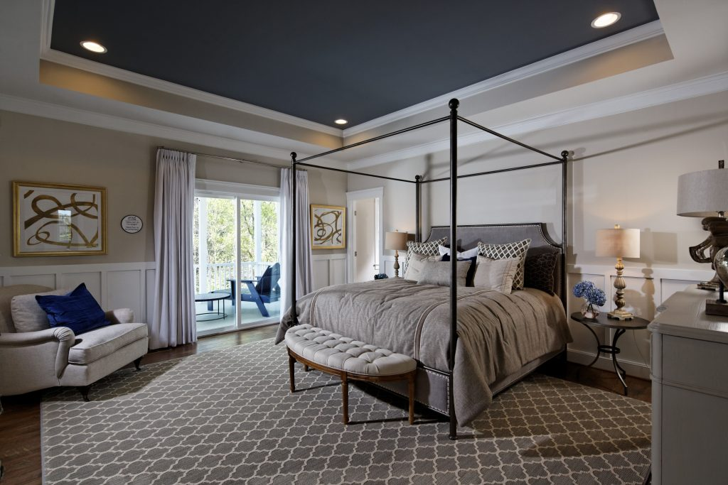A Patterned Area Rug Spans Across The Kensington Ii Models Master
