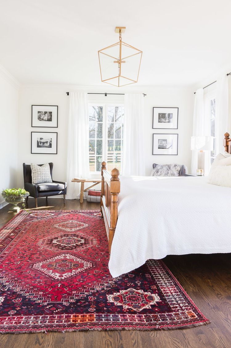 Bedroom White Walls White Bedding Antique Rug Seating