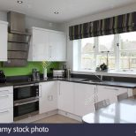 Black And White Modern Kitchen With Lime Green Splash Back Stock
