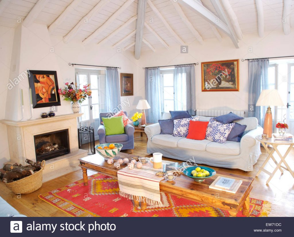 Colorful Cushions On White Sofa In Spanish Country Living Room With