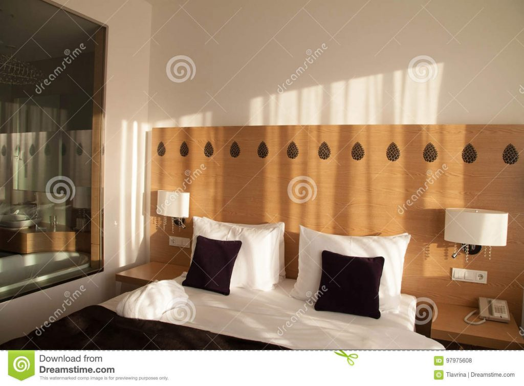 Contemporary Hotel Room With View And Glass Wall To Bathroom Stock