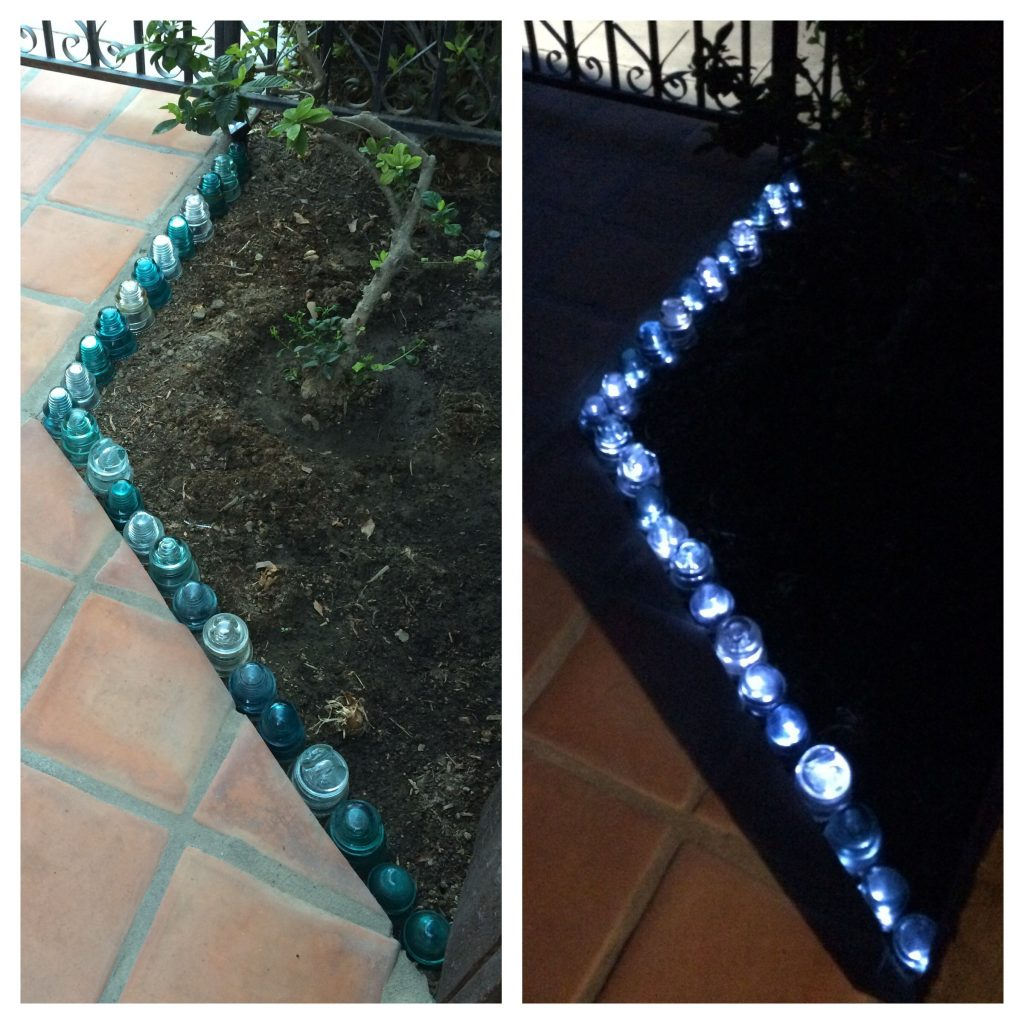 Glass Insulator Garden Border Lit Underneath With A String Of Solar