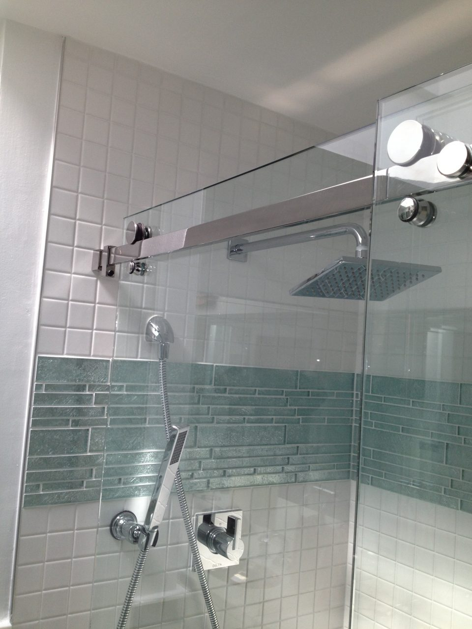 Glass Shower Room With White And Grene Wall Tile Connected