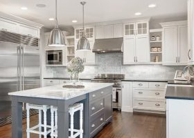 Kitchen with White Cabinets Grey Island
