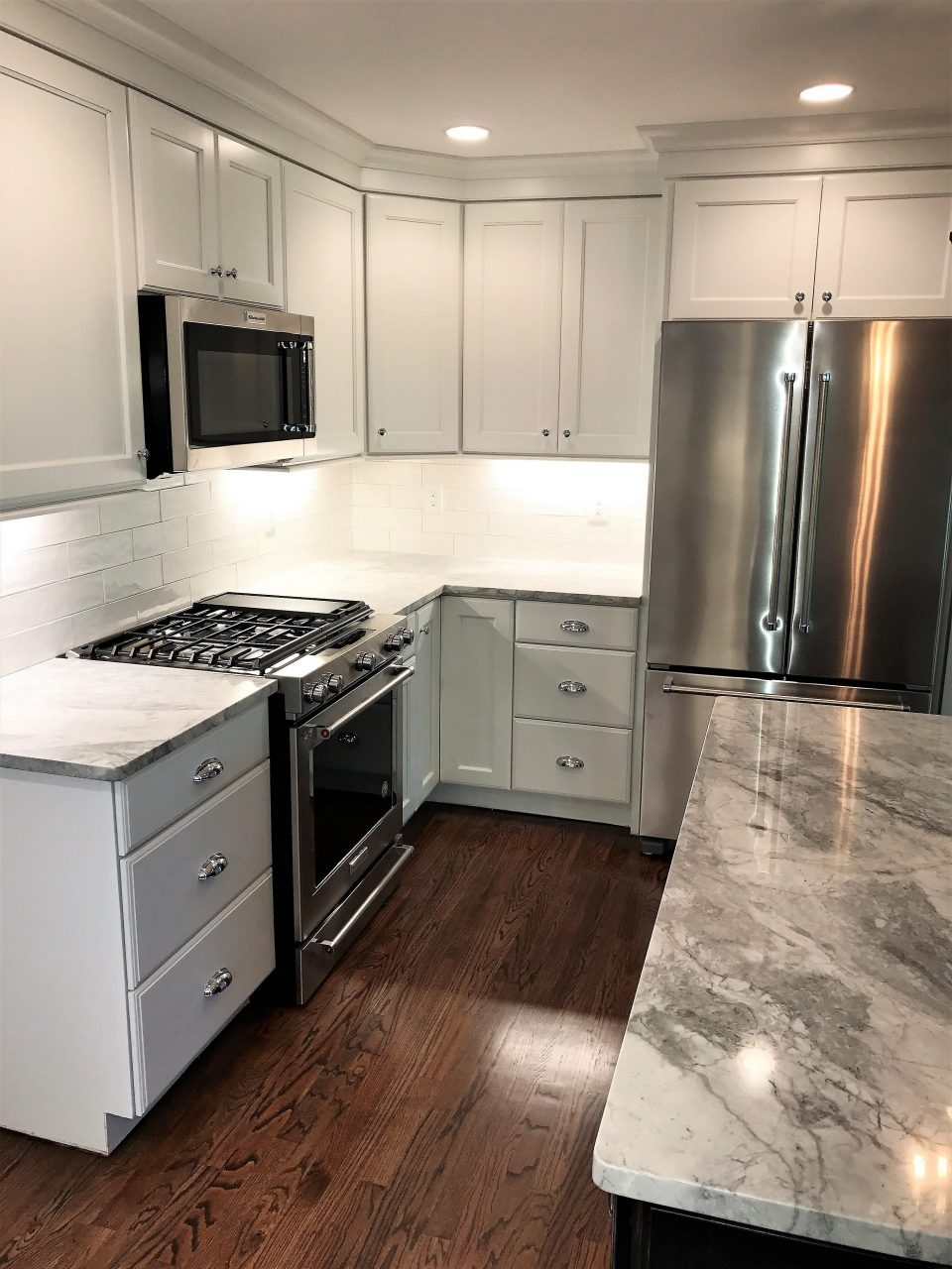 Kitchen Renovation In Grays And White Counter Tops Are Super White