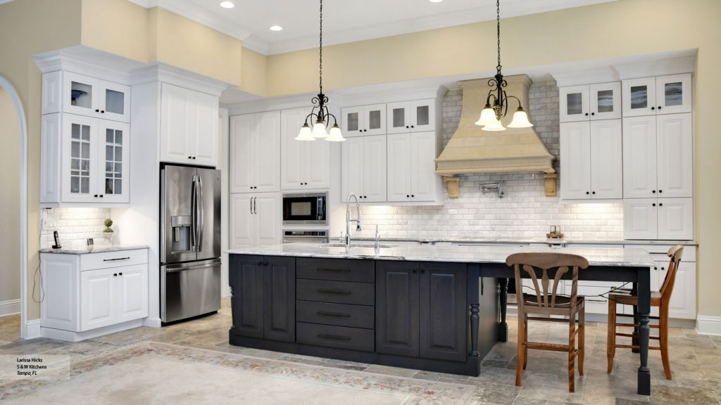 Kitchen With White Cabinets And A Gray Island Omega