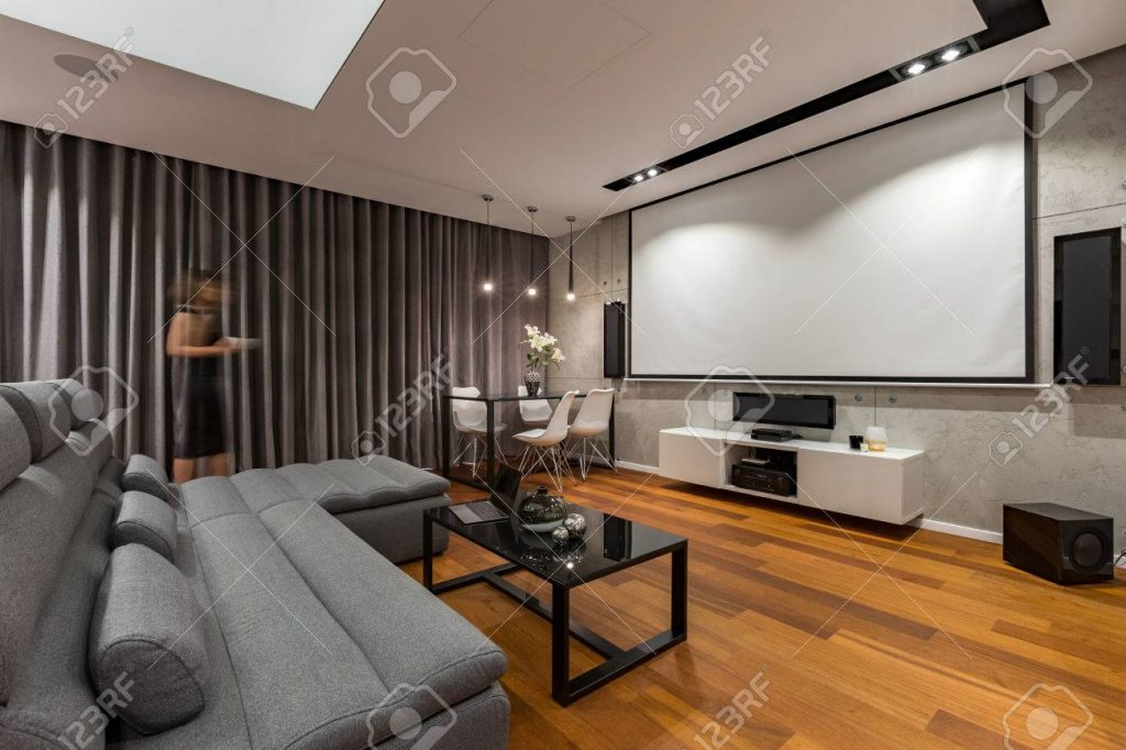 Living Room With Projector Screen Gray Couch And Black Coffee