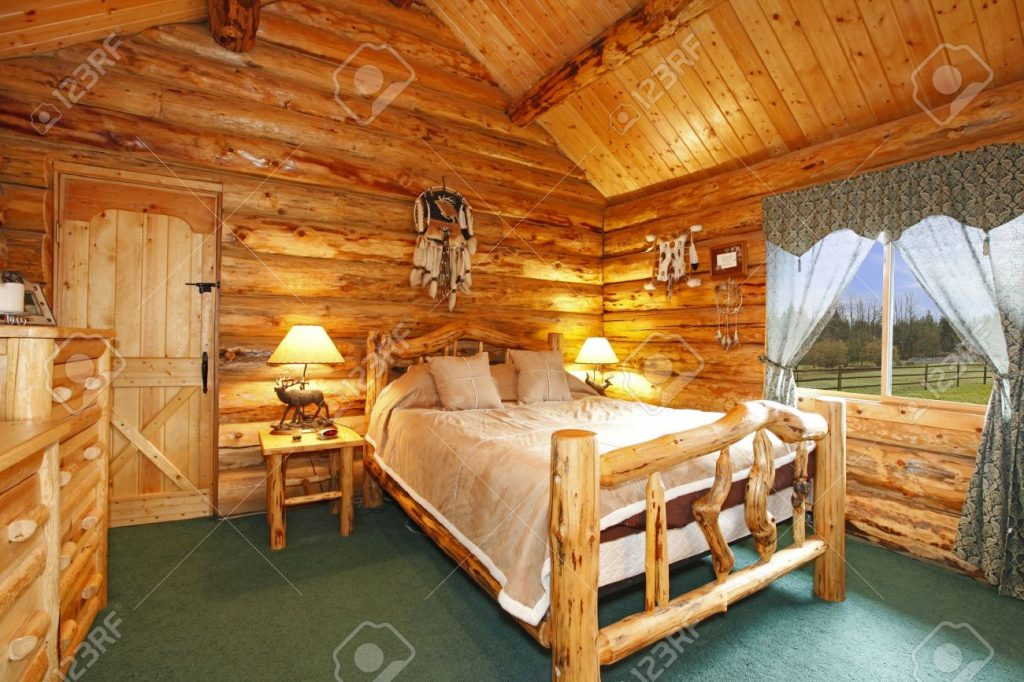 Log Cabin Bedroom With Rustic Wood Design Stock Photo Picture And