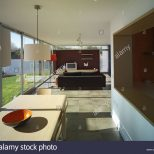 Modern Open Plan Kitchen Diner And Sitting Room With Floor To